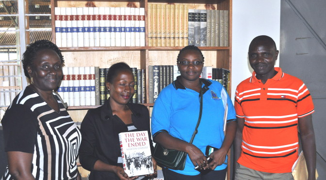 In the photo  from left to right Harriet Ntege - acting university librarian at Kyambogo University.  Diananatu Kundagt from  Pentecostal University, Mary Nabbosa - senior librarian from Kyambogo university, Paul Ngabirano Librarian from Kyambogo University